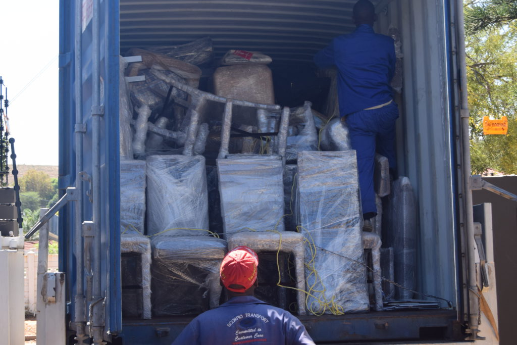 Workers Packing Container